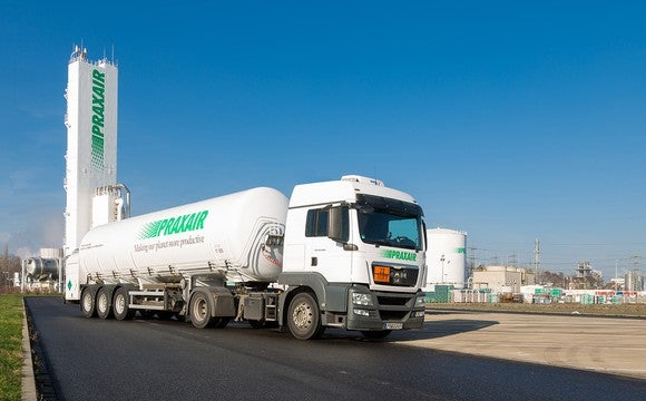 Semi tanker truck with Praxair markings on a road leaving a Praxair production facility.