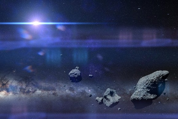 Asteroids against background of space