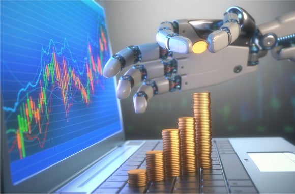A robot hand stacking coins in front of a financial chart.