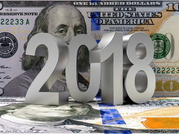 2018 in front of $100 bill