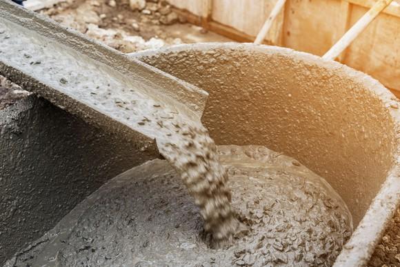 Cement mixer pouring into wheel barrel