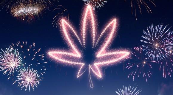 Fireworks show with fireworks shaped like marijuana leaf