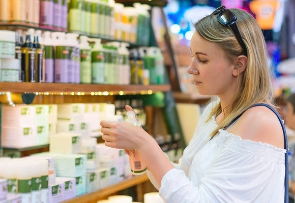 Woman shopping at bath accessories store.