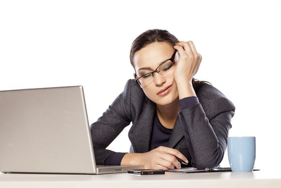 Professional woman falling asleep at her desk