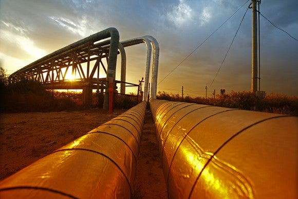 An energy pipeline at sunset.