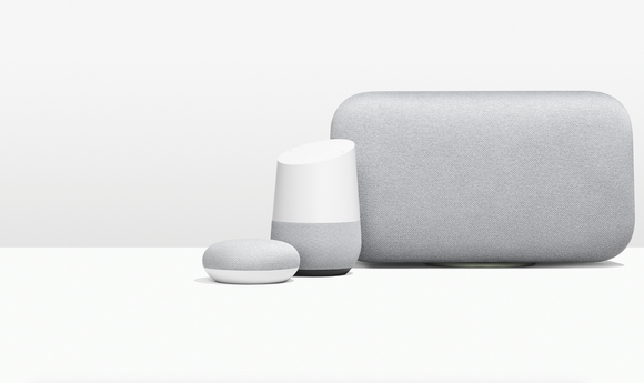 Google home smart speakers on a white table with grey background