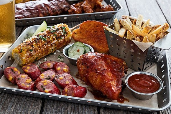 A platter of food including barbecue chicken and corn at Chili's.