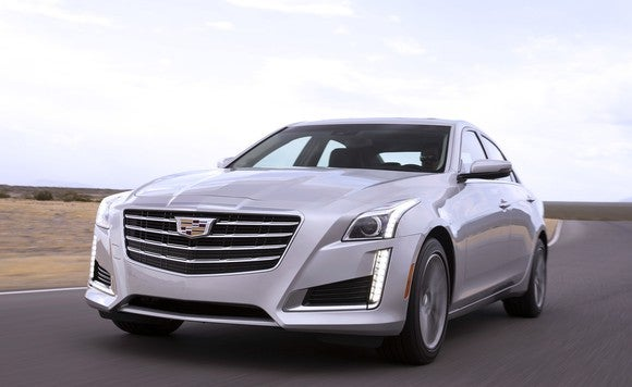 A silver Cadillac CTS luxury sedan on a country road.