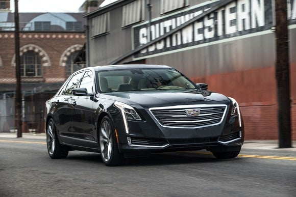 A black 2017 Cadillac CT6, a large luxury sedan, on a city street.
