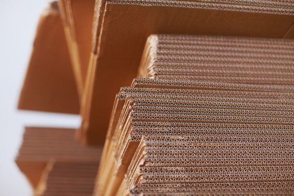 Close-up of clean corrugated cardboard sheets in a stack.