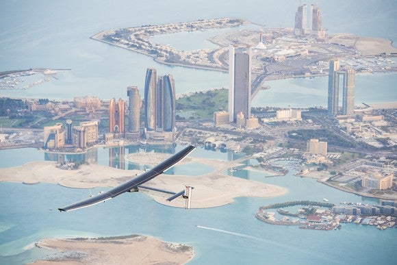 Solar plane flying over a city.