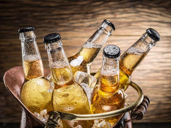 Beer bottles in an ice bucket