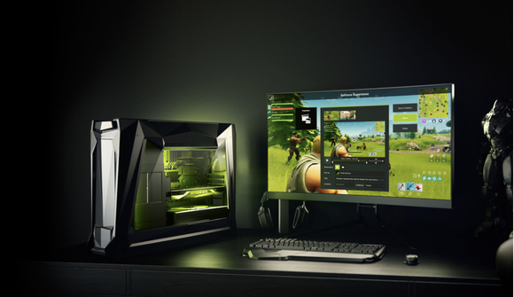 Desktop PC with a monitor displaying a game.