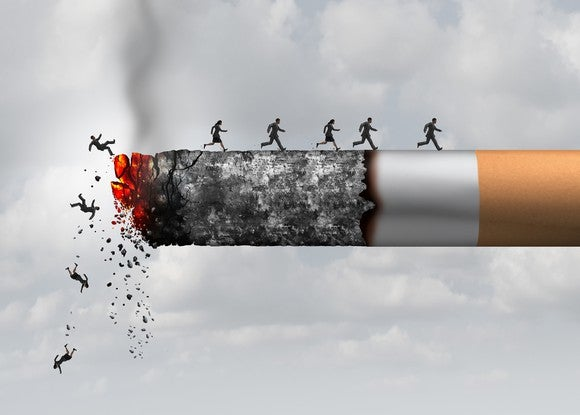 Miniature humans falling off of a burning cigarette