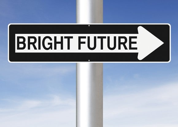 A sign on a pole, fashioned to look like a one-way sign, reads bright future.