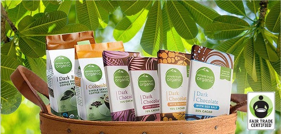 Bags of Simple Truth branded choclate in a basket. Certified Fair Trade label in the bottom right corner.
