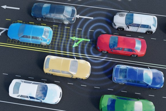 Overhead view of eight driverless cars -- four going each way -- traveling on a four-lane highway.