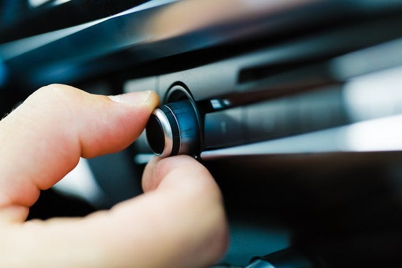 Turning on a car radio.