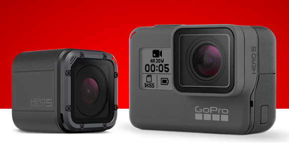 Two black GoPro cameras are featured in a glossy ad with a red and white backdrop