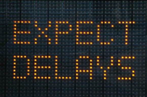 "Freeway sign that reads ""expect delays"""