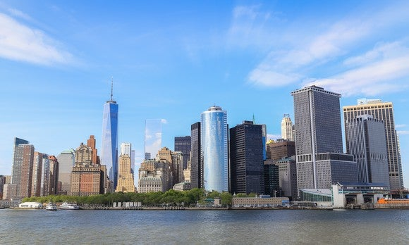 view of Freedom Tower and lower Manhattan from south looking north at south street seaport.
