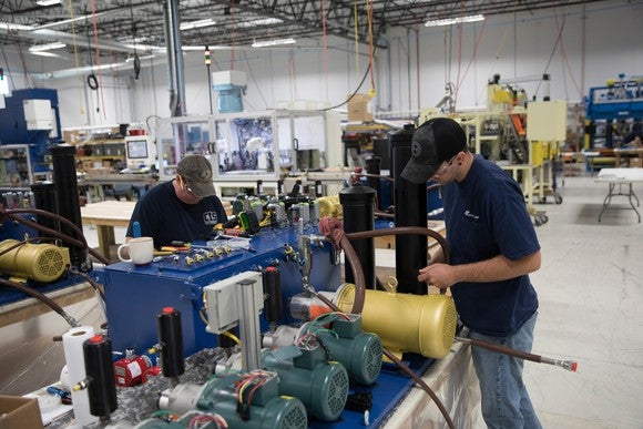 Manufacturing employees working at a U.S. Apple supplier
