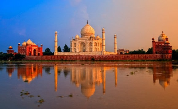 Taj Mahal viewed from a distance across the river.