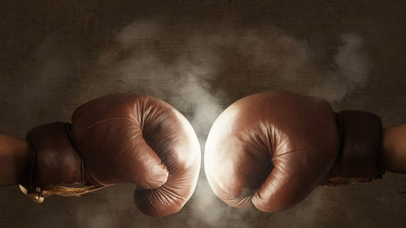 Two boxing gloves hitting each other