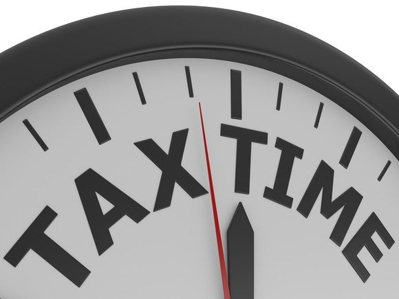 Analog clock that says tax time