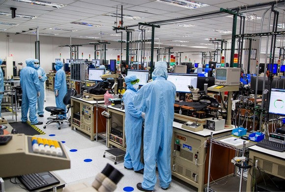 Workers in clean suits working on 3D sensing components