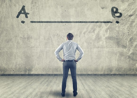 Man facing wall with line between points A and B