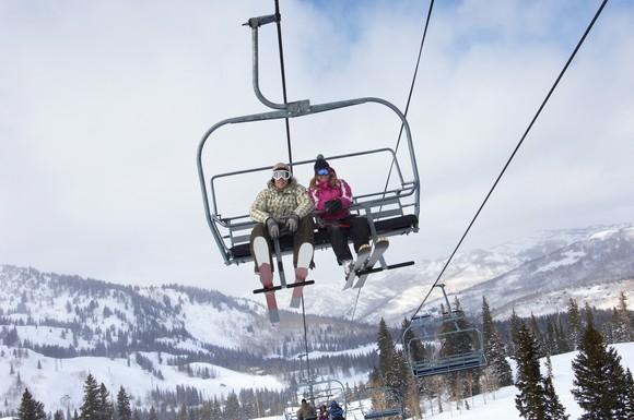 A couple riding a ski lift