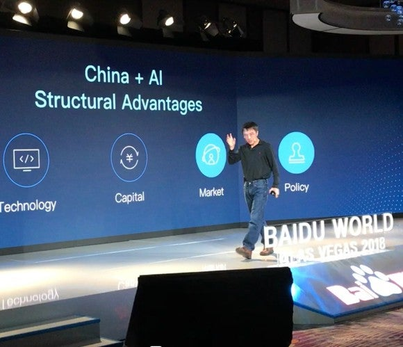Baidu COO Qi Lu presenting on stage at CES 2018.