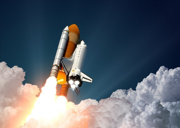 The space shuttle blasts off.
