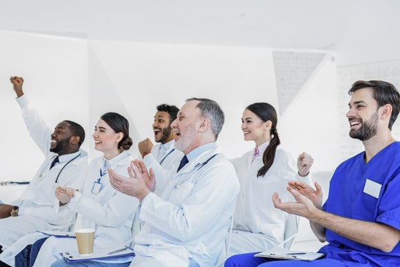 A group of doctors cheering.