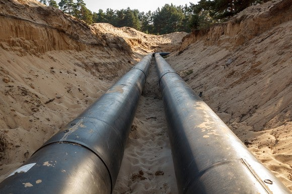 An uncovered pipeline construction site with sand around it.