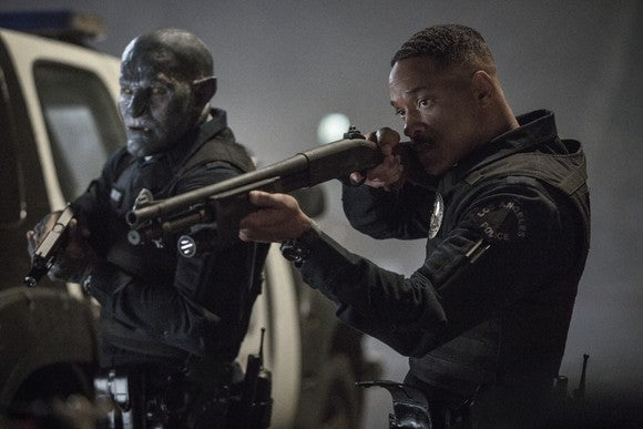Will Smith and Joel Edgerton point shotguns in a scene from movie Bright.