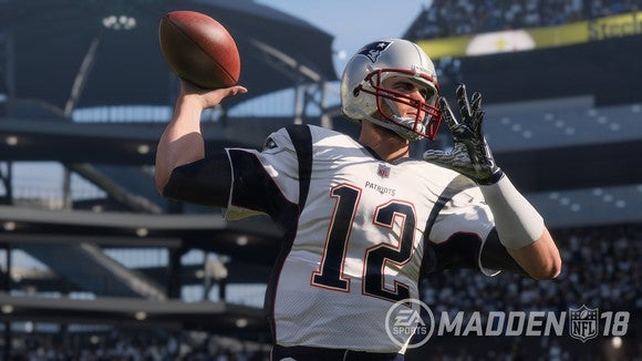 Screenshot from Madden NFL 18 video game showing a quarterback throwing a football.