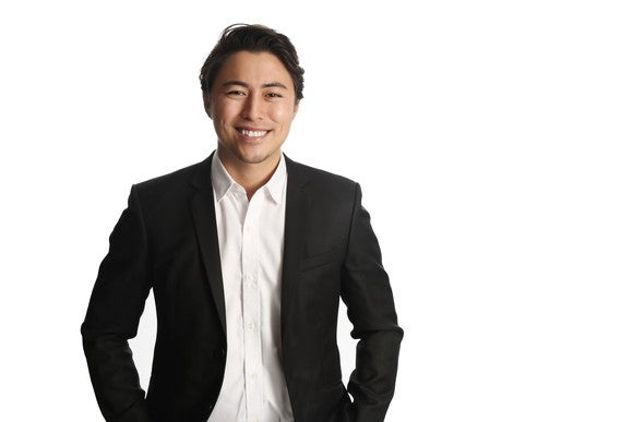 Smiling professional man against a white background
