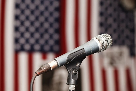 Microphone in front of two American flags
