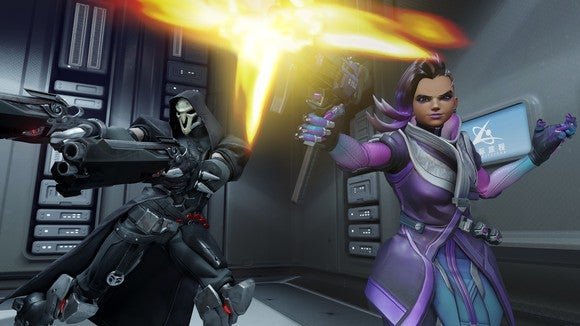 Overwatch characters Reaper and Sombra firing weapons at an unseen assailant.