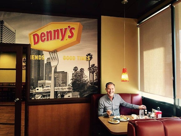 CEO Reed Hastings celebrating an earlier milestone at Denny's.