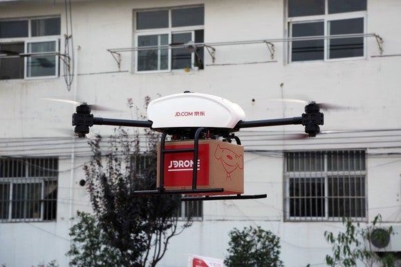 A drone carrying a package from JD.com