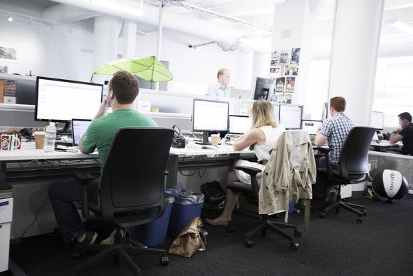 Zendesk employees working at their computers at the company's headquarters