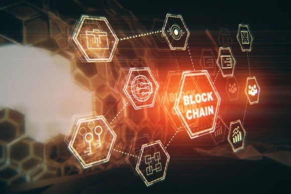 The word blockchain in a hexagon, surrounded by an array of symbols in hexagons.