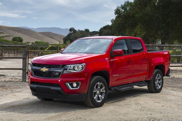 A red 2018 Chevrolet Colorado midsize pickup truck.