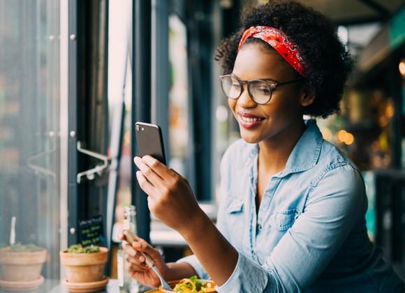 A woman checks her smartphone.