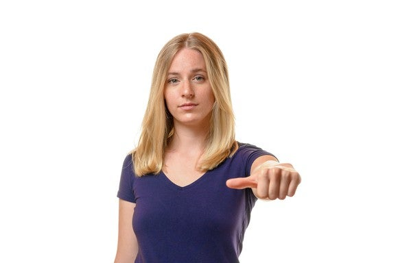 Woman holding thumb sideways