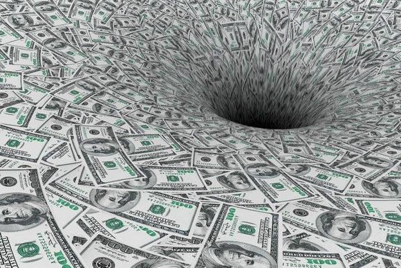 A huge expanse of hundred-dollar bills flowing down a sinkhole.