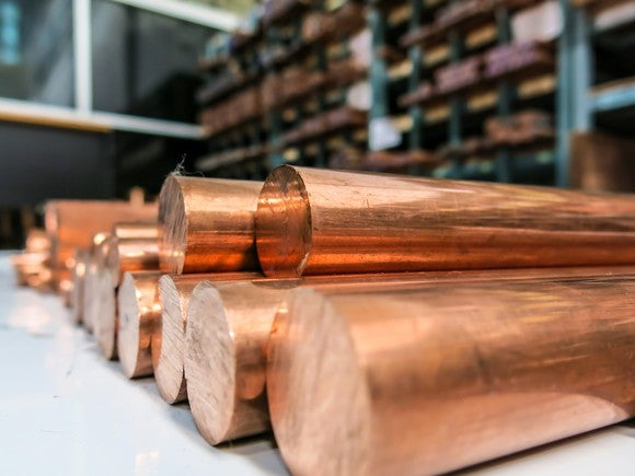 Copper cylinders stacked on top of each other in a storage room.